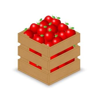Czerwone jabłko w drewnianej skrzyni