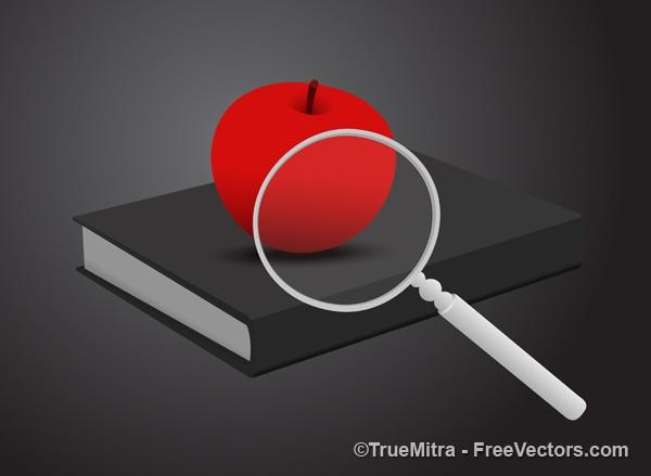 Czerwone jabłko z lupy na książki