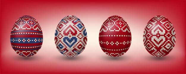 Czerwone jaja paschalne ozdobione wzorami dziewiarskimi