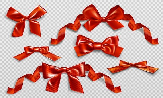 Czerwone kokardki z kręconymi wstążkami i wzorem serca.