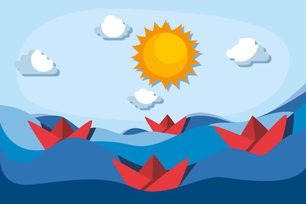 Czerwone papierowe łodzie na morzu