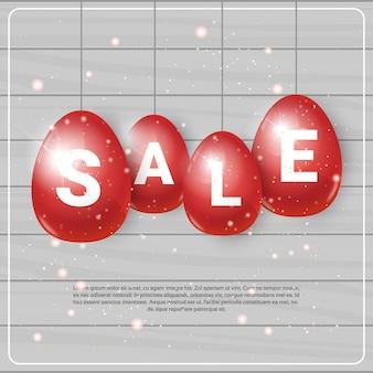 Czerwone pisanki z sprzedaż szablon wiszące transparent zakupy świąteczne