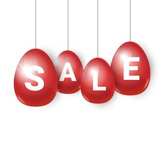 Czerwone pisanki ze sprzedaży wisi na białym, transparent zakupy na wakacje