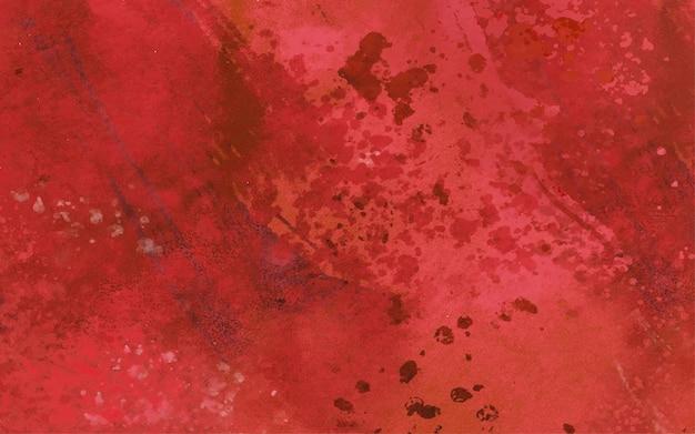 Czerwone plamy i krople na akwareli