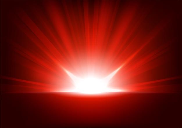 Czerwone promienie wzrasta na ciemnym tle