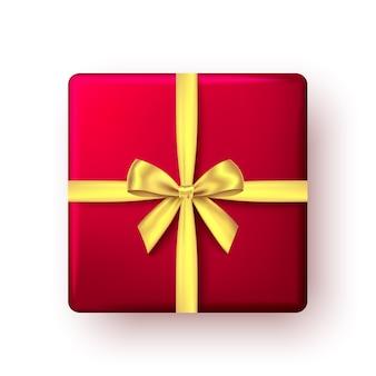 Czerwone pudełko ze złotą wstążką i kokardą