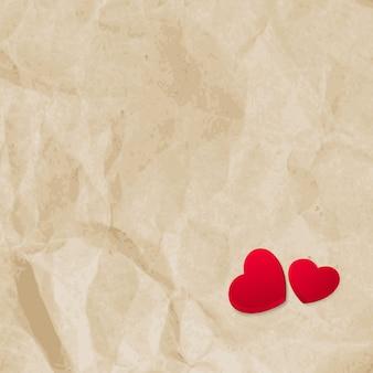 Czerwone serca na rocznika tle papieru z lato.
