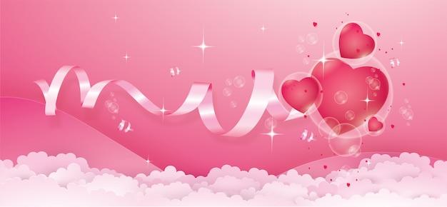 Czerwone serca w bańce unoszą się na różowym kolorze