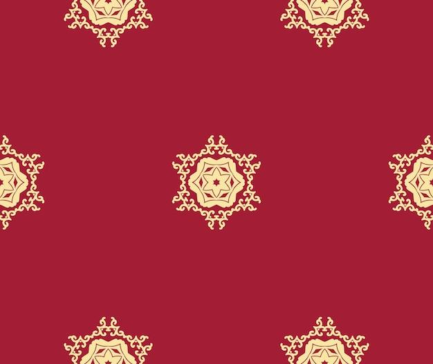 Czerwone tło boże narodzenie ze złotym ornamentem arabeska boże narodzenie bezszwowe tło z płatkami śniegu