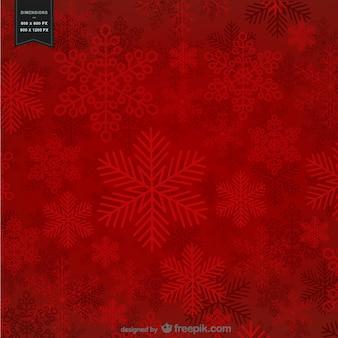 Czerwone tło z płatki śniegu na boże narodzenie