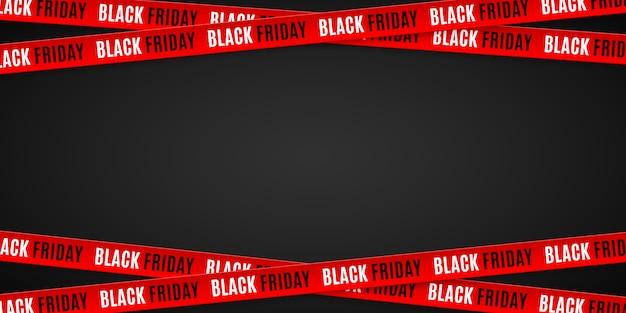 Czerwoni faborki dla czarnej piątek sprzedaży na czarnym tle.