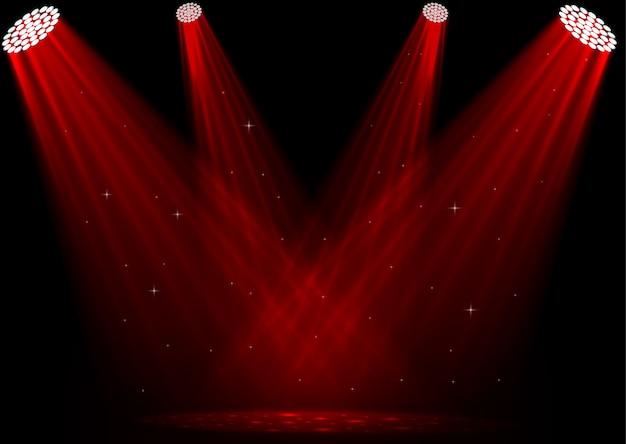 Czerwoni światła reflektorów na ciemnym tle