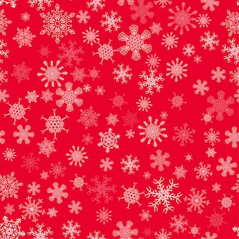 Czerwony bezszwowy boże narodzenie wzór z różnymi płatkami śniegu