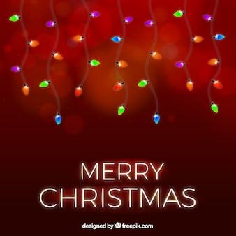 Czerwony bożego narodzenia tło z bożonarodzeniowe światła