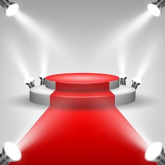Czerwony dywan na podium z reflektorami