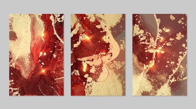 Czerwony i złoty wzór z teksturą geody i błyszczy abstrakcyjne tło wektor w technice atramentu alkoholowego nowoczesna farba z brokatem zestaw teł dla projektu plakatu banerowego sztuka płynna