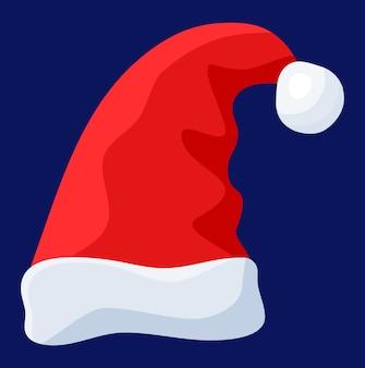 Czerwony kapelusz świętego mikołaja na białym tle na niebieskim tle.