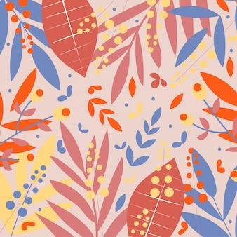 Czerwony, niebieski i żółty tropikalnych liści na beżowym tle