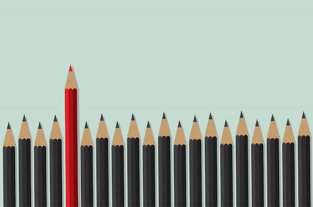 Czerwony ołówek stoi przed czarnym tłumem