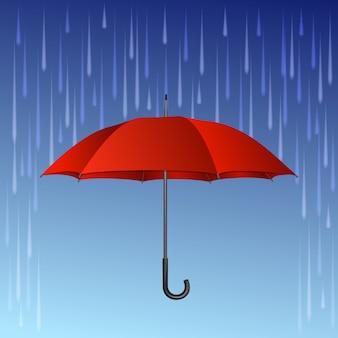 Czerwony parasol i krople deszczu