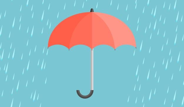 Czerwony parasol z kroplami deszczu