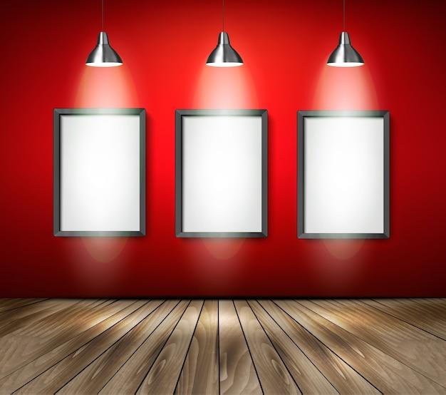 Czerwony pokój z reflektorami i drewnianą podłogą.