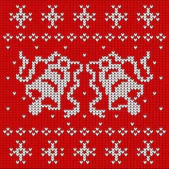 Czerwony sweter z dzianiny z dwoma dzwoneczkami