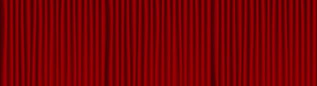 Czerwony teatr drapuje tło.