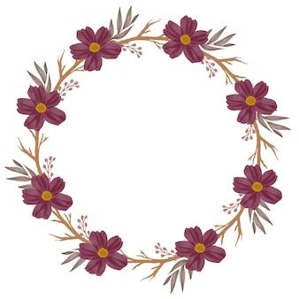 Czerwony wieniec koło ramki z czerwonym kwiatem i brązową gałązką na zaproszenie na ślub