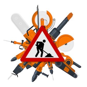 Czerwony znak budowy z narzędziami elektrycznymi z tyłu