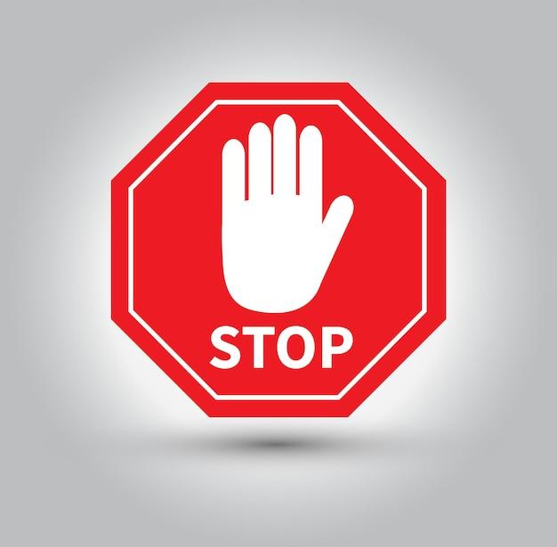 Czerwony znak stop na białym tle na szarym tle
