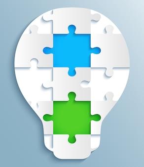 Część zagadek w postaci żarówek. kreatywny z kolorowymi puzzlami
