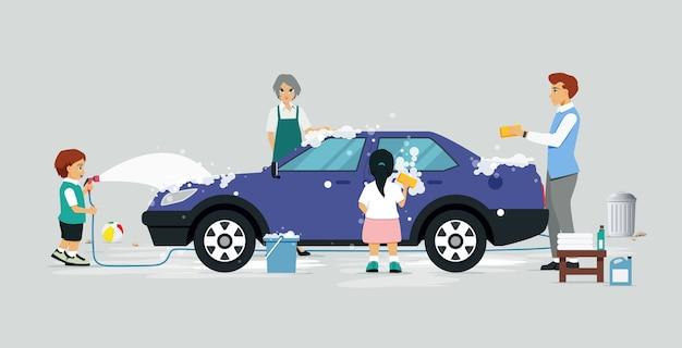 Członkowie rodziny bawią się myjnią samochodową