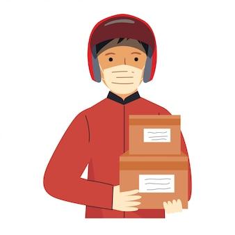 Człowiek dostawy podczas pandemii covid-19. zapobieganie koronawirusowi. kurier nosi maskę z pudełkiem w rękach.