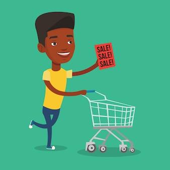 Człowiek działa w pośpiechu do sklepu na sprzedaż.