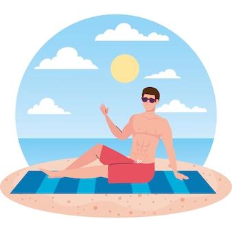 Człowiek leżący, opalanie na plaży, w sezonie letnim