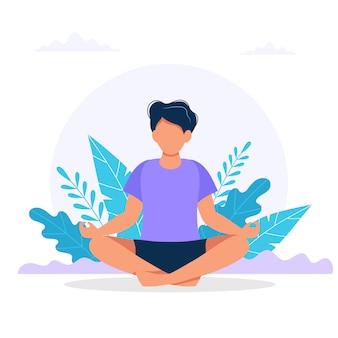 Człowiek medytuje w naturze.
