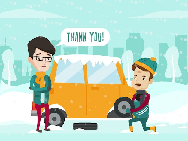 Człowiek pomaga zmienić oponę samochodową na zimowej drodze.