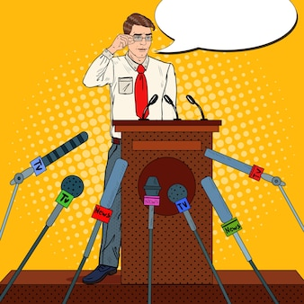 Człowiek posiadający konferencję prasową