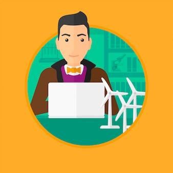 Człowiek pracuje z model turbin wiatrowych na stole.