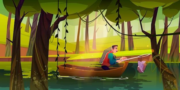 Człowiek rybacki w łodzi łowiący ryby w sieci na leśnym jeziorze lub stawie w lecie