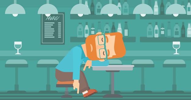 Człowiek śpi w barze.