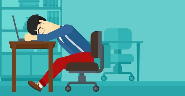 Człowiek śpi w miejscu pracy.