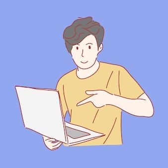 Człowiek, wskazując na laptopa w ręku wyciągnąć