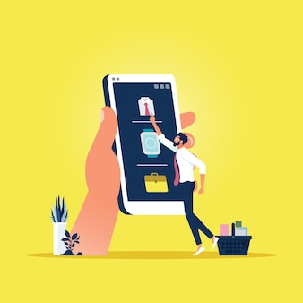 Człowiek wybiera produkty na ekranie telefonu i wkłada do koszyka, marketing cyfrowy
