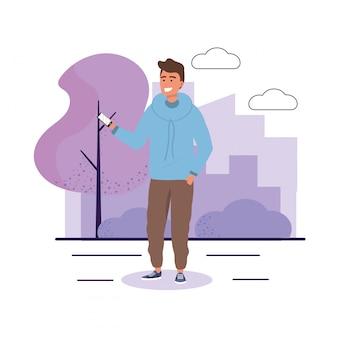 Człowiek z technologią smartfonów i krzewów roślin