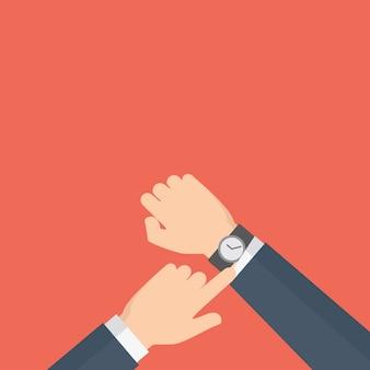 Człowiek z zegarem sprawdza czas