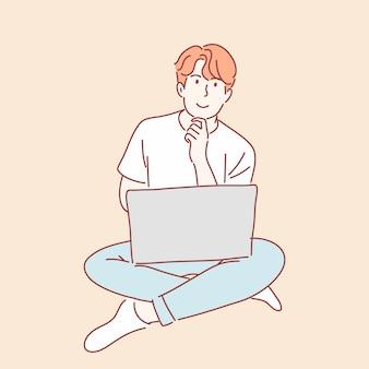 Człowiek za pomocą laptopa w wyciągnąć rękę