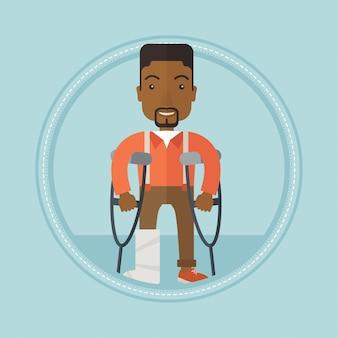 Człowiek ze złamaną nogą i kulami