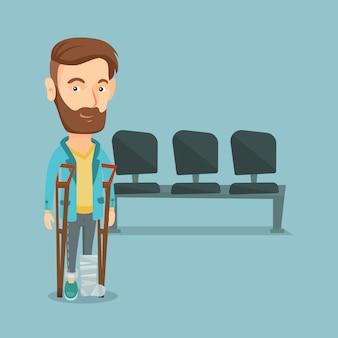 Człowiek ze złamaną nogą i kulami.
